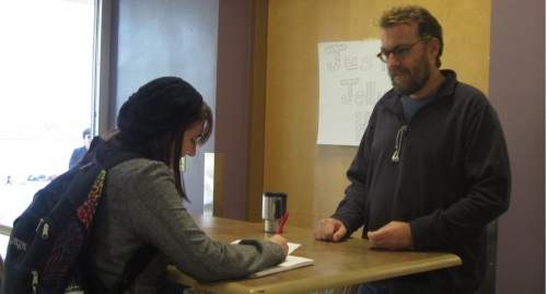 Journalism one student and English major Alex Korcz interviewing English Professor David Rice as part of the National Day on Writing (Photo Credit: Alyssa DeGilio. Saint Rose Chronicle)